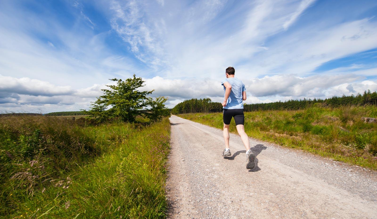 Man running through farm field